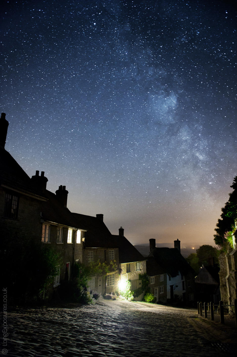 "The Milky Way rises above Gold Hill in Shaftesbury. The town falls within Dorset's ""switch off"" zone for streetlighting, creating excellent conditions for stargazing."