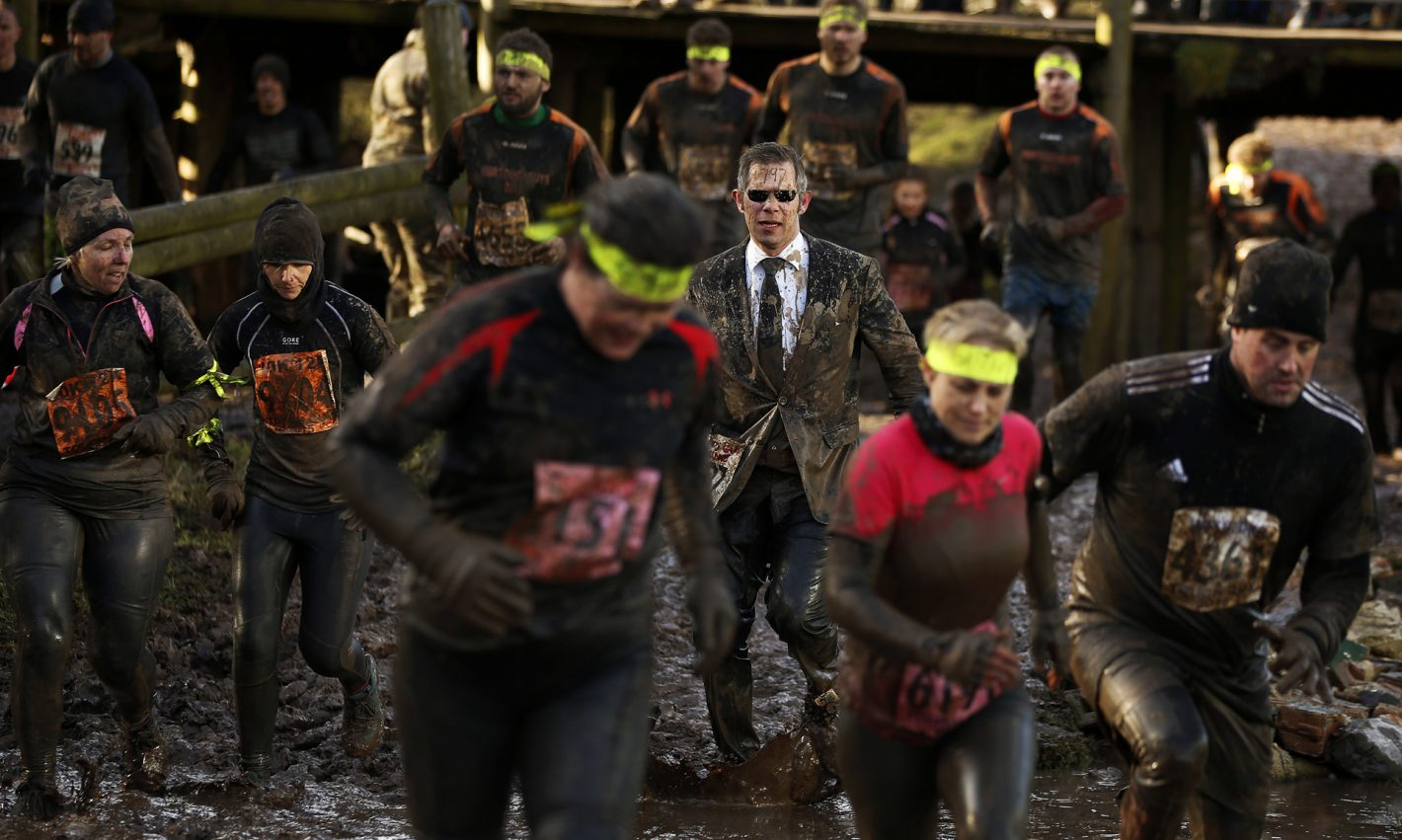 Competitors run through mud during the Tough Guy event in Perton, central England February 1, 2015. The annual event to raise cash for charity challenges thousands of international competitors in a cross country run followed by an assault course consisting of obstacles including water, fire and tunnels. REUTERS/Phil Noble (BRITAIN - Tags: SPORT SOCCER TPX IMAGES OF THE DAY) - RTR4NSE6