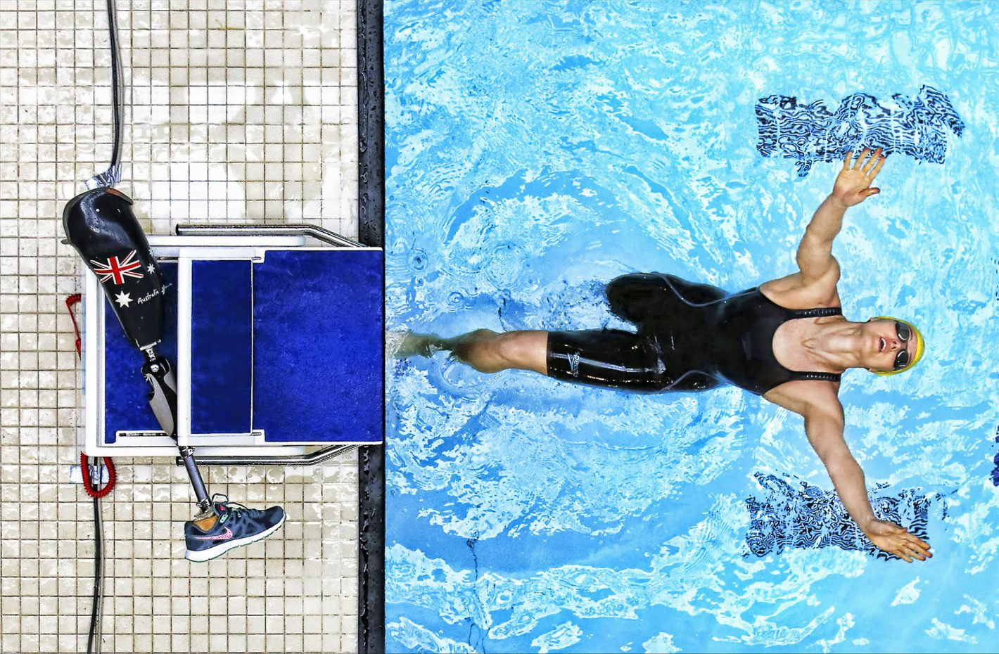 GLASGOW, SCOTLAND - JULY 19: Ellie Cole of Australia dives into the pool during Day Seven of The IPC Swimming World Championships at Tollcross Swimming Centre on July 19, 2016 in Glasgow, Scotland. (Photo by Ian MacNicol/Getty Images) *** Local Caption *** Ellie Cole