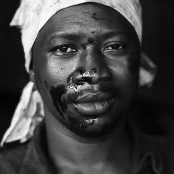 Ismail Osman (32) works as a mechanic specialised in Japanese cars, in Suame Magazine, Kumasi, Ghana, August 2015. Suame Magazine is an industrialized area with many workshops for metal engineering and vehicle repairs in Ghana, employing an estimated 200,000 workers. It is located 10 kilometers from Kumasi, the capital of the Ashanti Region. It is in the Suame constituency of Ghana and part of the KMA's administrative district. It is the most industrialized zone in Ghana and one of the largest industrialized zones in Africa