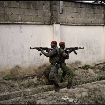 Two Special Forces soldiers, on duty as the newly elected Vice President, Namadi Sambo, demonstrate their skills to photographer, in Kaduna, Nigeria, the 28th of April 2011.