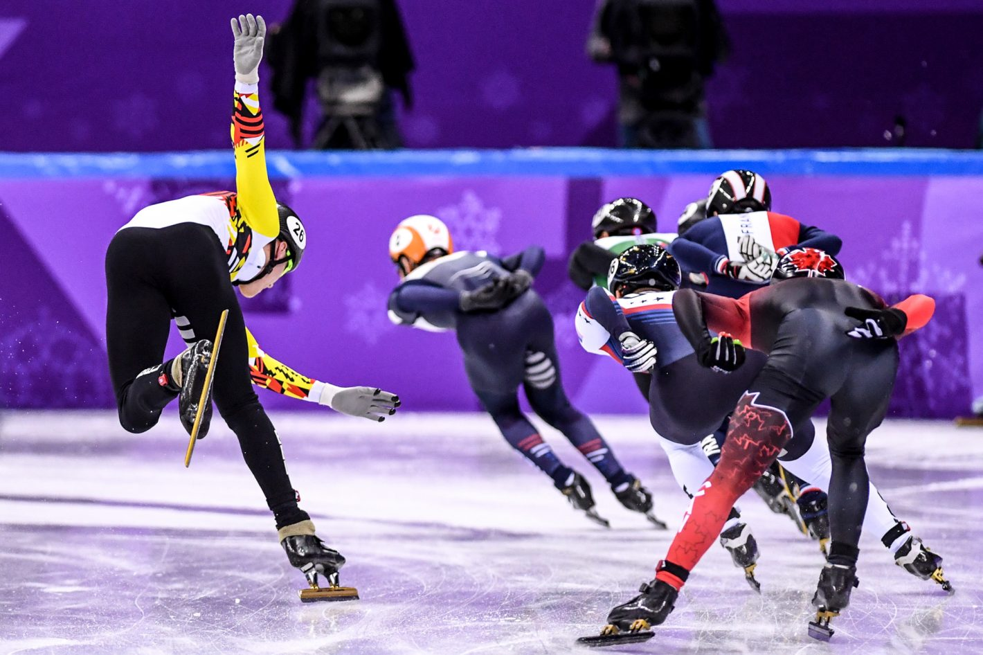 Jens Almey of Belgium loses balance in a corner while others skate smoothly during the 2nd group of Men's 1,500m Semifinal on February 10, 2018. Nikon D5 | AF-S NIKKOR 300mm f/2.8G ED VR II | ISO 6400 | 1/5000 s | f/2.8 Copyright: An Ling Jung / China Sports