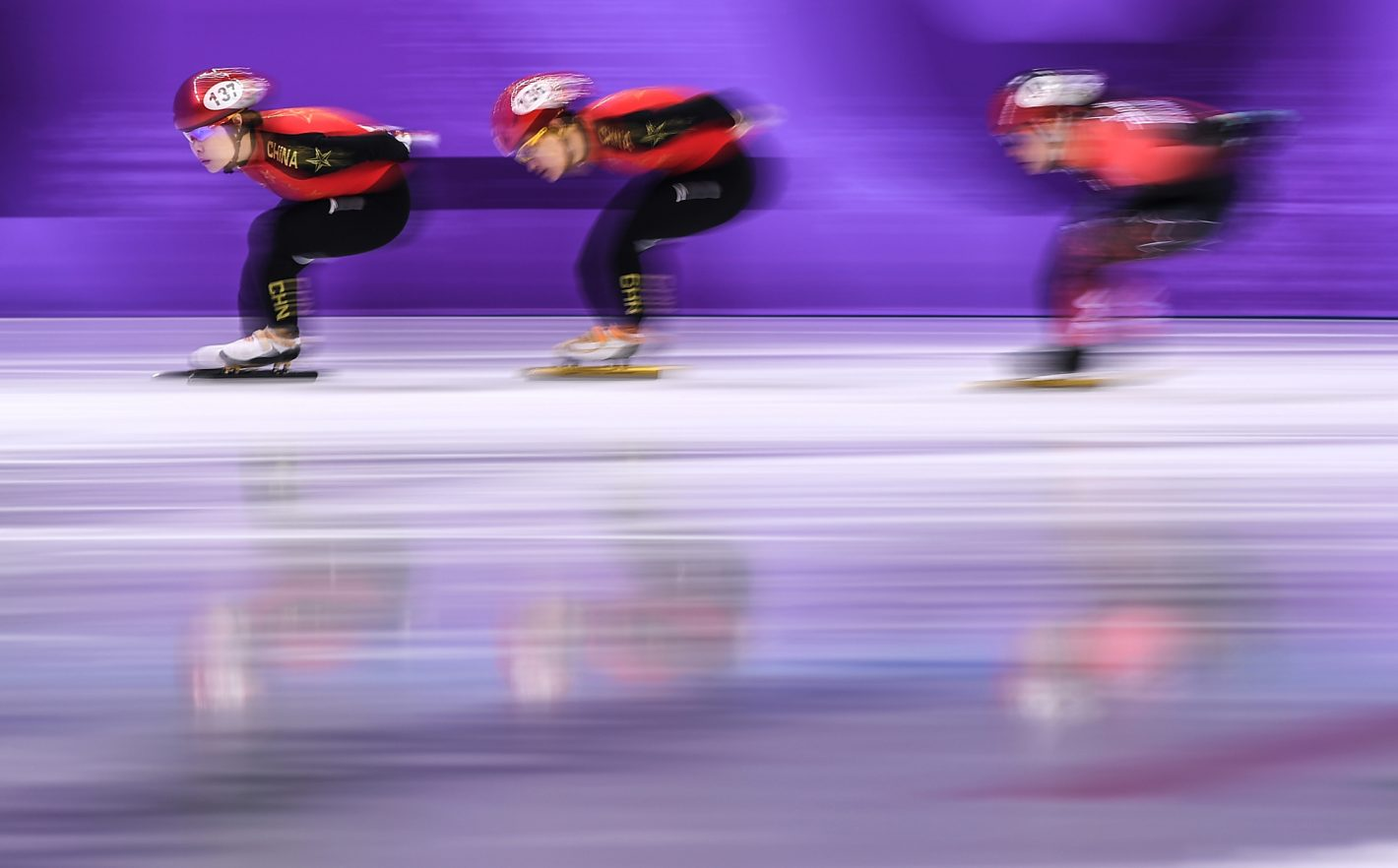 Two Chinese skaters in relaying area during the Women's 3,000m relay qualifier on February 10, 2018. Nikon D5 | AF-S NIKKOR 300mm f/2.8G ED VR II | ISO 50 | 1/13 s | f/6.3 Copyright: An Ling Jung / China Sports