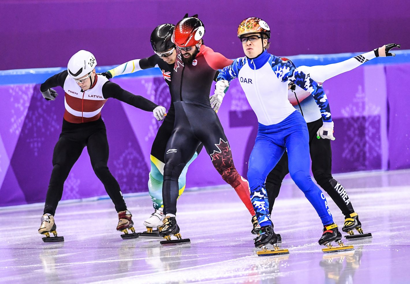 Skaters compete to cross the finish line during the 1st group of Men's 1,500m Semifinal on February 10, 2018. Nikon D5 | AF-S NIKKOR 300mm f/2.8G ED VR II | ISO 6400 | 1/5000 s | f/2.8 Copyright: An Ling Jung / China Sports