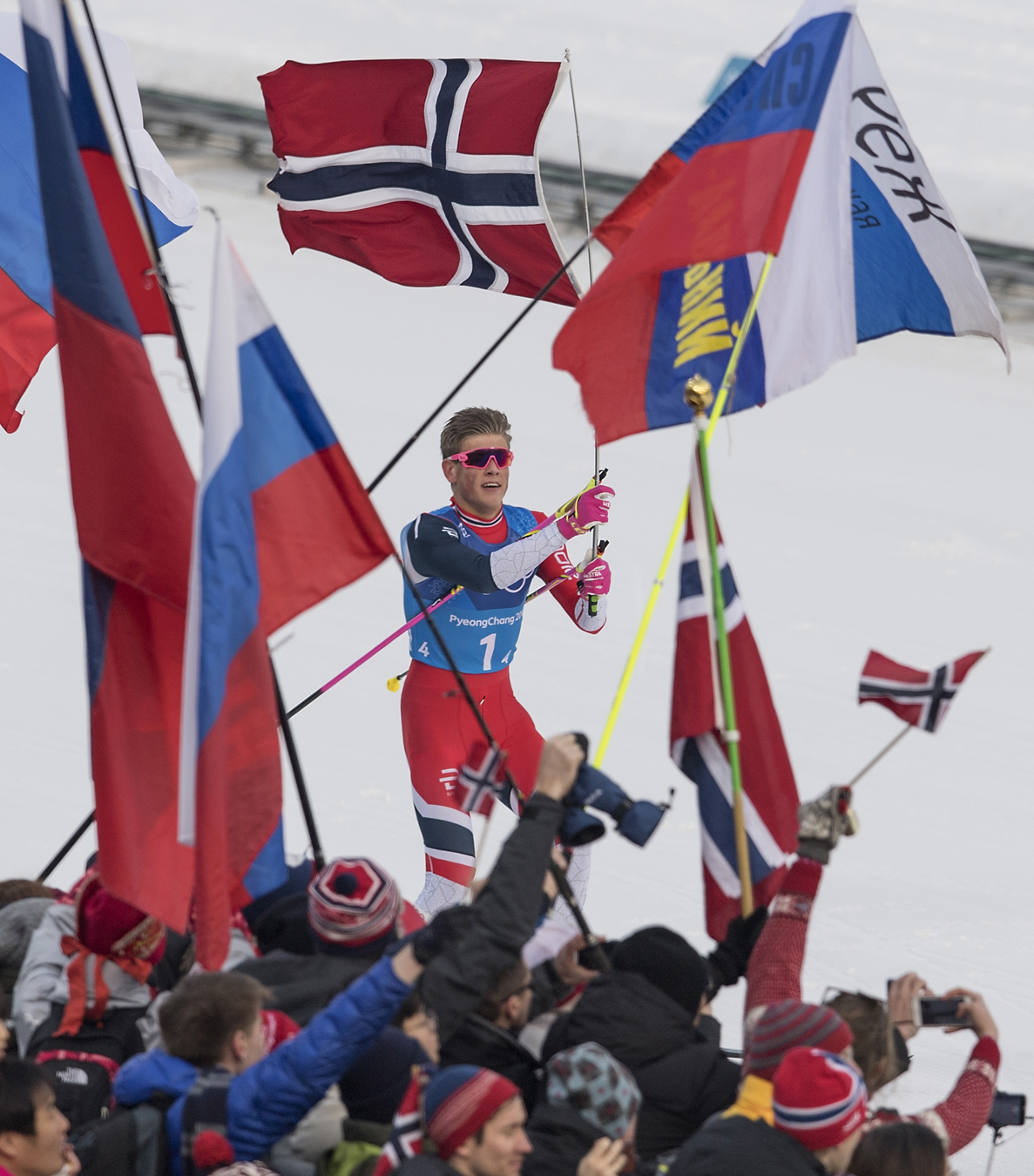 Johannes Hoesflot Klaebo (NOR) first place, with flag on the finishline, Cross-Country Skiing, Men's 4 x 10km Relay, Alpensia Cross-Country Skiing Centre on February 12, 2018 during the PyeongChang 2018 Winter Olympic Games. Nikon D5 | AF-S NIKKOR 400mm f/2.8E FL ED VR | ISO 250 | 1/1600 s | f/4.0 Photo by Anke Wälischmiller/ FOTOAGENTUR SVEN SIMON