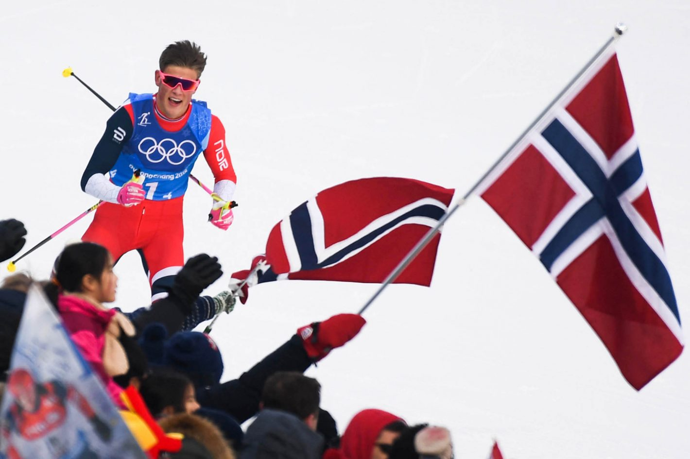Feb 18, 2018; Pyeongchang, South Korea; Johannes Hoesflot Klaebo (NOR) reacts as he crosses the finish line in cross-country skiing mens 4x10km relay during the Pyeongchang 2018 Olympic Winter Games at Alpensia Cross-Country Centre. Mandatory Credit: James Lang-USA TODAY Sports Model: NIKON D5 Serial #: 3006880 Firmware: Adobe Photoshop CC 2017 (Macintosh) Frame #: 9267 Lens (mm): 500 ISO: 450 Aperture: 5.6 Shutter: 1/1000 Exp. Comp.: +0.3