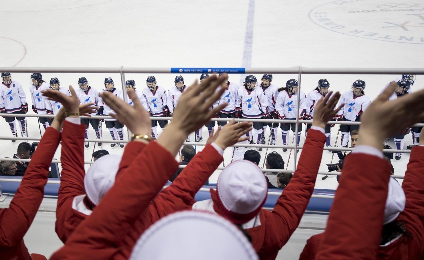 """After the game: Team Korea standing right in front of the """"Army of Beauties"""" – North Korean Cheerleaders. Women's Ice Hockey Preliminary Round Switzerland vs. Korea at Kwandong Hockey Centre on February 10, 2018 during the PyeongChang 2018 Winter Olympic Games. Nikon D850 