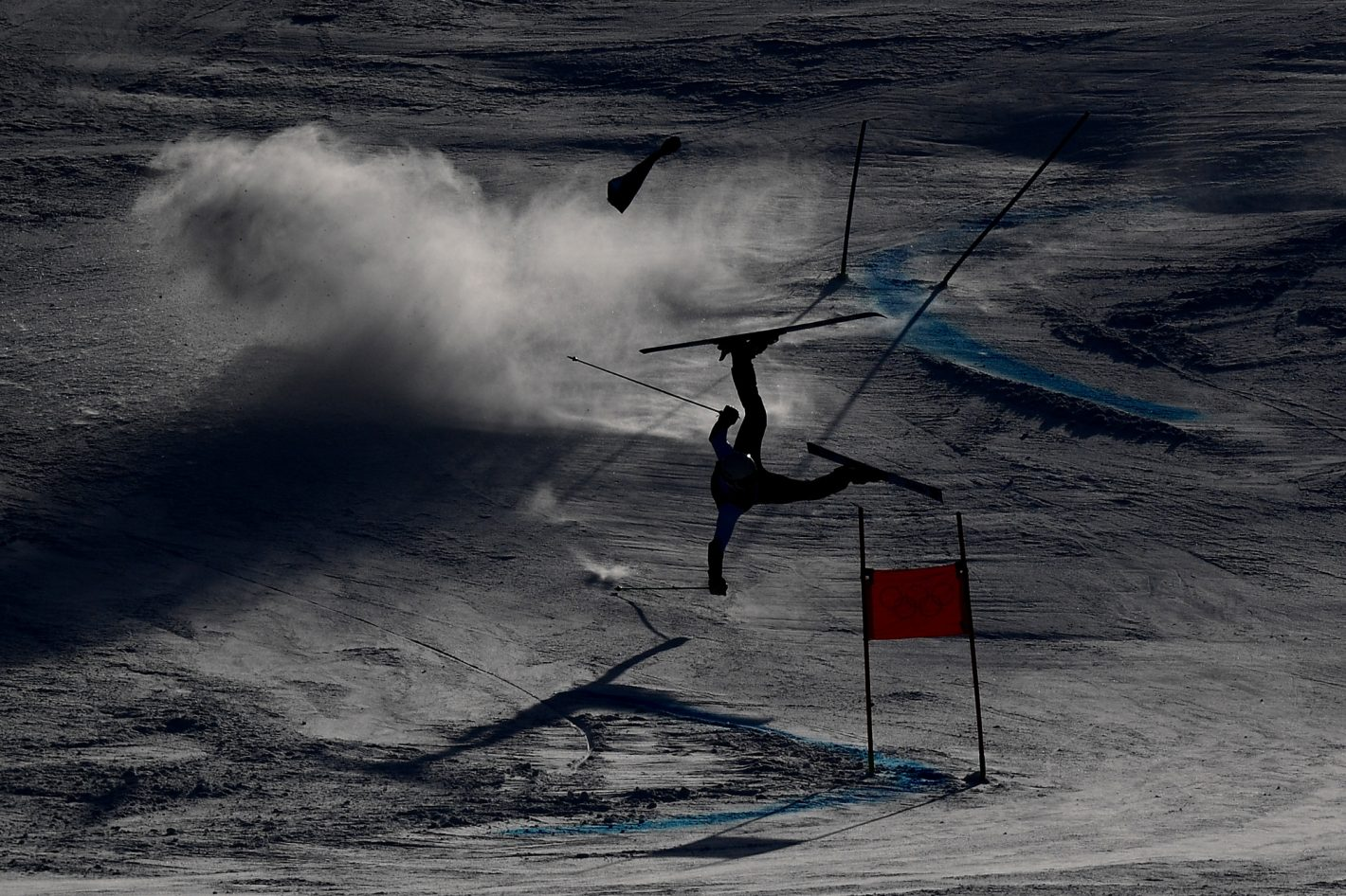 A forerunner crashes prior to the Alpine Skiing Men's Giant Slalom on day nine of the PyeongChang 2018 Winter Olympic Games at Yongpyong Alpine Centre on February 18, 2018 in Pyeongchang-gun, South Korea. Nikon D5 | AF-S NIKKOR 180-400mm f/4E TC1.4 FL ED VR @550mm | ISO 160 | 1/5000s | f/7.1 Photo by Matthias Hangst/Getty Images