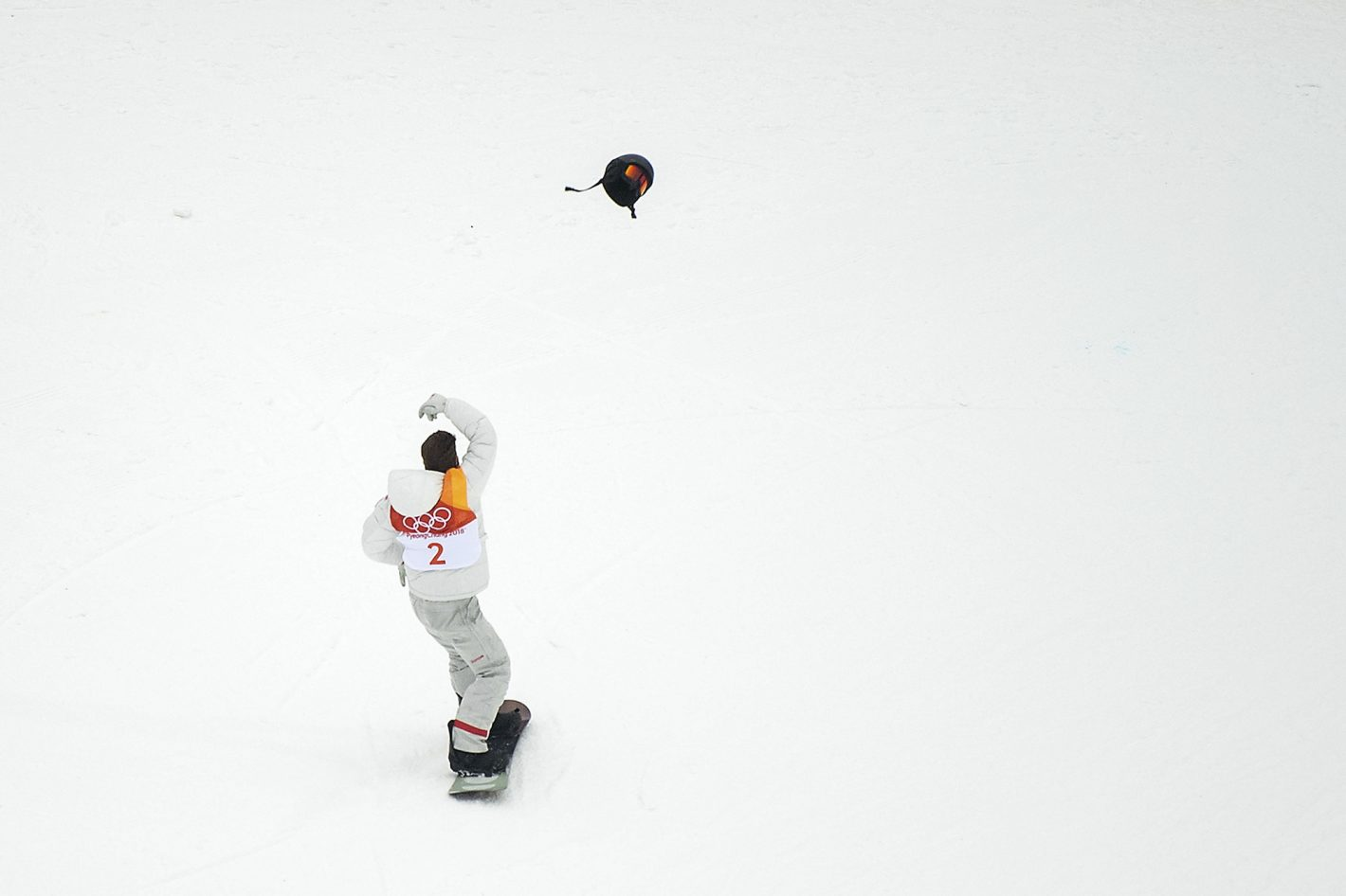 Gold medallist Shaun White of the United States throws his helmet as he celebrates after his first round during Snowboard Men's Halfpipe Final on day five of the Pyeongchang 2018 Winter Olympics at Phoenix Snow Park on February 14, 2018 in Pyeongchang-gun, South Korea. Nikon D5 | AF-S NIKKOR 70-200mm f/2.8E FL ED VR @200mm | 1/2000s | F2.8 Photo by David Ramos/Getty Images